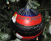 "Washington, DC - December 3, 2008 -- Close-up of one of the 369 hand-colored ornaments on the White House Christmas Tree in the Blue Room of the White House during a media preview of the 2008 holiday decorations and tasting event in Washington, D.C. on Wednesday, December 3, 2008.  Each ornament was commissioned by individual members of Congress to ""characterize the unique, patriotic spirit of the artist's state, district or territory. This ornament is from North Carolina. Every member of the United States House and Senate were invited by Mrs. Bush to participate.  The theme of this years decorations is ""a Red, White, and Blue Christmas""..Credit: Ron Sachs / CNP"