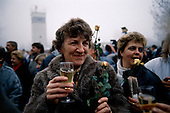 Ostpreu Bendamm, West Germany<br /> November 14, 1989  <br /> <br /> An unidentified woman holds up champagne at to celebrate as East Germans go to West Germany. Germans gathered as the wall is dismantled and the East German government lifts travel and emigration restrictions to the West on November 9, 1989.