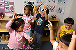 Preschool 3-4 year olds music dance activity grou playing horizontal