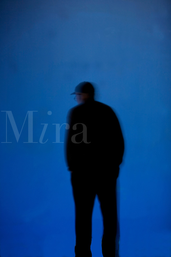 Silhouette of people against a blue background