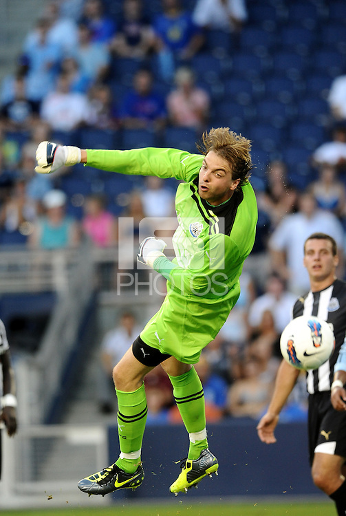 Newcastle United goalkeeper Tim Krul punches the ball wide of the goal... Sporting Kansas City and Newcastle United played to a scoreless tie in an international friendly at LIVESTRONG Sporting Park, Kansas City, Kansas.
