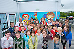 DISPLAY: The pupils of Fenit NS who completed a series of murals, display them at the school on Thursday.   Copyright Kerry's Eye 2008
