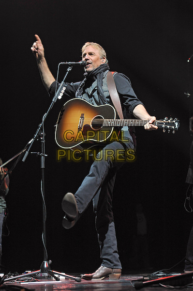 Kevin Costner .Kevin Costner & Modern West Live in concert, Saint Petersburg, Russia, April 11th 2013..on stage gig music performing full length grey gray black top waistcoat scarf shirt guitar playing hand finger leg kicking singing .CAP/PER/VB.©VB/PersonaStars/CapitalPictures