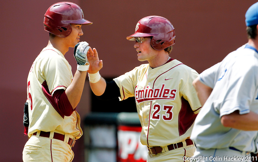 TALLAHASSEE, FL 4/24/11-FSU-DUKE BASE11 CH-Florida State's Sean O'Brien, left, and James Ramsey celebrate Ramsey scoring in the seventh inning against Duke Sunday at Dick Howser Stadium in Tallahassee. FSU scored six runs in the inning to reclaim the lead. The Seminoles beat the Blue Devils 13-9...COLIN HACKLEY PHOTO