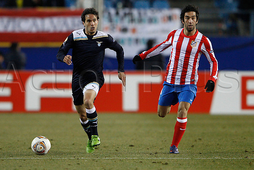 23.02.2012, SPAIN -  UEFA Europa League match played between Atletico de Madrid vs S.S. Lazio (1-0) at Vicente Calderon stadium. Picture show Alvaro Rafael Gonzalez Luengo (Lazio) and Arda Turan (Turkish midfielder of At. Madrid)