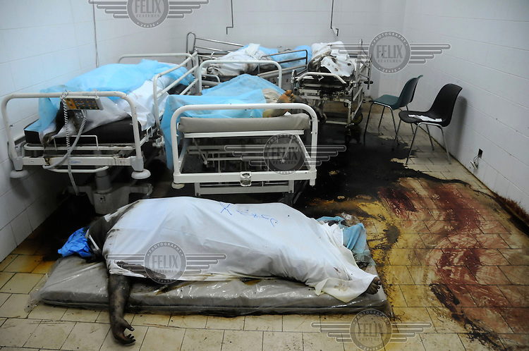 Decomposing bodies lie on beds inside the Abu Salim hospital where about 80 dead bodies were discovered after fighting in the area subsided. Its not clear how they died but it seems that some who were being treated there succumbed to their injuries as a result of being abandoned by hospital staff who fled the fighting while others were shot to death while lying in their beds. After six months of revolution it appears that the 42 year regime of Gaddafi has come to an end and the former dictator is currently on the run.