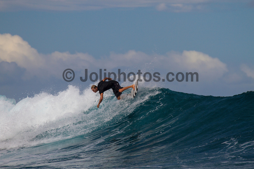 Namotu Island Resort, Fiji. (Sunday, May 13, 2012) -  The wind had dropped today and the cloud cover lifted. There were waves at Cloudbreak, Namotu Lefts and Swimming Pools while the fish were also biting..Photo: joliphotos.com
