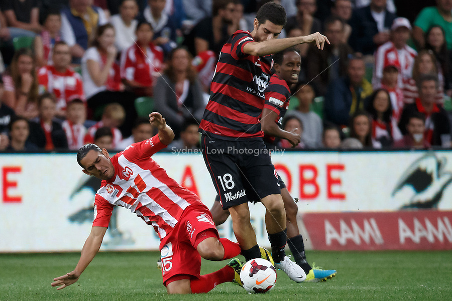 David WILLIAMS of the Heart and Iacopo LA ROCCA of the Wanderers fight for the ball in the round 27 match between Melbourne Heart and  the Western Sydney Wanderers in the Australian Hyundai A-League 2013-24 season at AAMI Park, Melbourne, Australia. Photo Sydney Low/Zumapress<br /> <br /> This image is not for sale on this web site. Please visit zumapress.com for licensing
