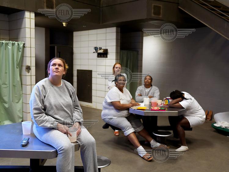 Women inmates watching television at Putnam County Jail.