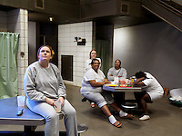 Women inmates watching television at Putnam County Jail.