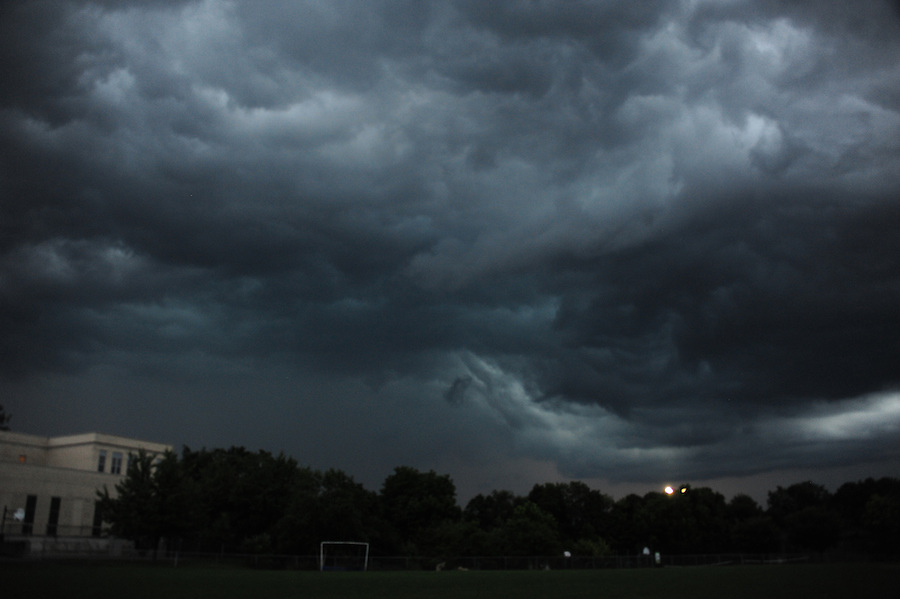 Jim Mendenhall Photos. Storm clouds with a cold front coming into a very warm front creating turbulence and lighting.August 28, 2016  copyright Jim Mendenhall 2016. Cold front collides with warm front and the resulting lighting, thunder and rain pass by Mt. Lebanon's Markham Elementary School. These were taken facing south east roughly facing toward the Laurel Highlands where Connellsville got 5 inches of rain in two hours. These are the property of Jim Mendenhall Photos only. Not any media company property. All rights reserved.