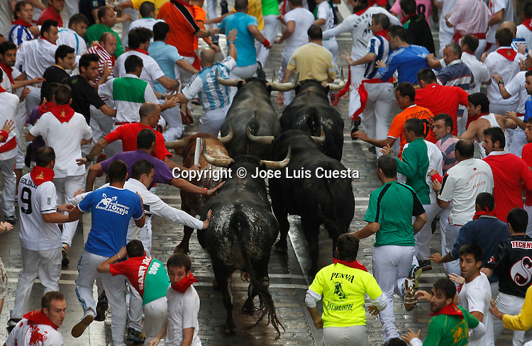 Eighth day of bull run in Estafeta street, Pamplona, northern of Spain.  San Fermin festival is worldwide known because the daily running bulls.