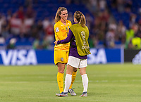 LYON,  - JULY 2: Alyssa Naeher #1 talks to Karen Carney #20 during a game between England and USWNT at Stade de Lyon on July 2, 2019 in Lyon, France.