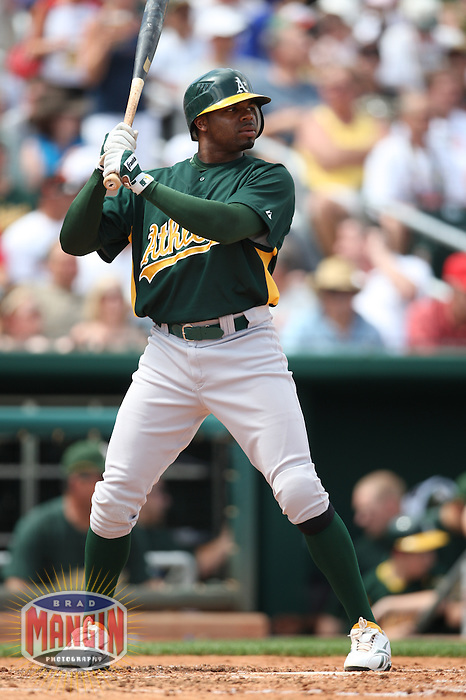GOODYEAR, AZ - MARCH 20:  Rajai Davis of the Oakland Athletics bats during a spring training game against the Cleveland Indians at Goodyear Ballpark in Goodyear, Arizona on March 20, 2009.  Photo by Brad Mangin