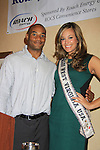 Andrea Rogers (Miss West Virginia USA) poses with Sports Celebrity Virginia Tech, NFL, WFL wide receiver Shawn Scales at the 33rd Annual Mountain State Apple Harvest Festival (MSAHF) 2012 on October 20, 2012 at the Bob Elmer Celebrity Sports Breakfast sponsored by the Rotary Club in Martinsburg, West Virginia. (Photo by Sue Coflin/Max Photos)