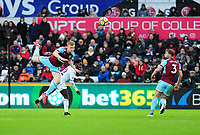 Burnley's Ben Mee vies for possession with Swansea City's Nathan Dyer<br /> <br /> Photographer Ashley Crowden/CameraSport<br /> <br /> The Premier League - Swansea City v Burnley - Saturday 10th February 2018 - Liberty Stadium - Swansea<br /> <br /> World Copyright &copy; 2018 CameraSport. All rights reserved. 43 Linden Ave. Countesthorpe. Leicester. England. LE8 5PG - Tel: +44 (0) 116 277 4147 - admin@camerasport.com - www.camerasport.com