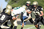 Palos Verdes, CA 10/30/09 - Kyle Nunn (MC# 19) is tackled by Tommy Kim (#8) and Kai Nelson (#33) during the Peninsula-Mira Costa football game.
