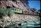 RGS RMRRC excursion southbound along the San Miguel River near Fall Creek.  A good view of &quot;Edna&quot; and the gondolas.  Consist is cabooses #0400 and #0401, three gondolas and business car B-20 &quot;Edna&quot;.<br /> RGS  Fall Creek, CO  Taken by Kindig, Richard H. - 9/1/1951