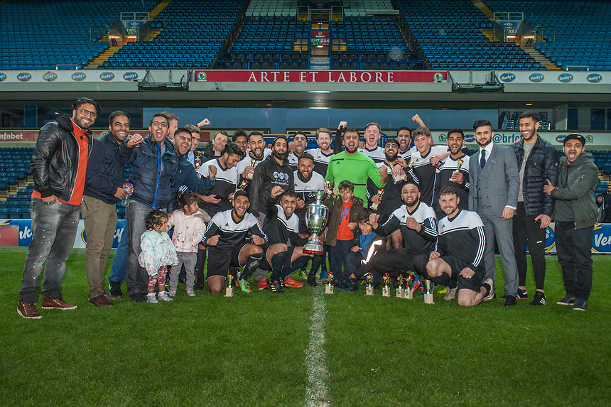 Coppice United players celebrate with the Asian Image cup following the AMT Lawyers Asian Image Cup Final at Ewood Park, Blackburn on Friday 11th May 2018.