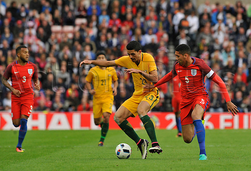 27.05.2016. Stadium of Light, Sunderland, England. International Friendly. England versus Australia. Chris Smalling of England and Tomas Rogic of Australia challenge for the ball