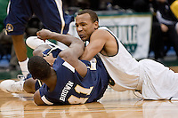 January 14, 2012:   Jacksonville Dolphins guard Evin Graham (5) and East Tennessee State Buccaneers forward Isiah Brown (41) battle for a loose ball during Atlantic Sun conference action between the Jacksonville University Dolphins and East Tennessee State University Buccaneers at Veterans Memorial Arena in Jacksonville, Florida.   East Tennessee State defeated Jacksonville 72-58.