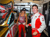 Sep 2, 2016; Clermont, IN, USA; NHRA top fuel driver Leah Pritchett and Papa Johns pizza founder John Schnatter during qualifying for the US Nationals at Lucas Oil Raceway. Mandatory Credit: Mark J. Rebilas-USA TODAY Sports