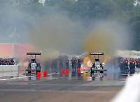 Aug 19, 2018; Brainerd, MN, USA; NHRA top fuel driver Scott Palmer (left) races alongside Leah Pritchett during the Lucas Oil Nationals at Brainerd International Raceway. Mandatory Credit: Mark J. Rebilas-USA TODAY Sports