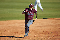Jakob Divers (2) of the Concord Mountain Lions hustles towards third base against the Wingate Bulldogs at Ron Christopher Stadium on February 2, 2020 in Wingate, North Carolina. The Mountain Lions defeated the Bulldogs 12-11. (Brian Westerholt/Four Seam Images)