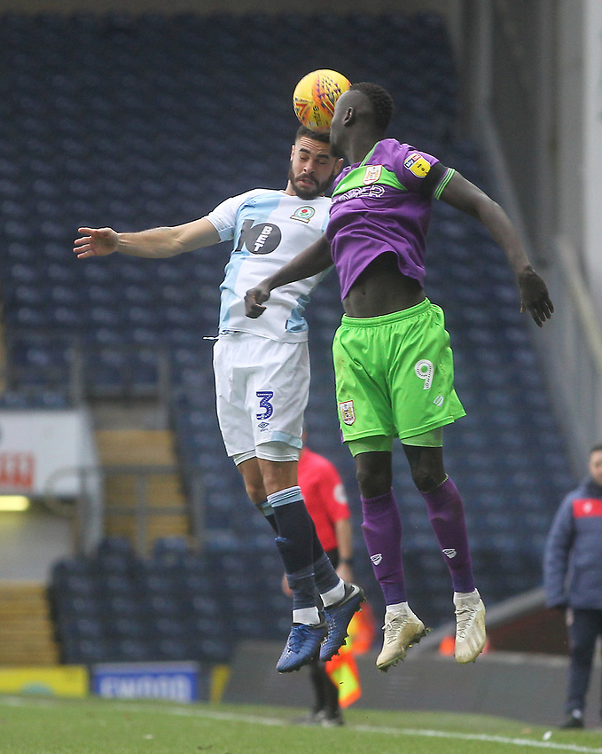 Blackburn Rovers Derrick Williams jumps with Bristol City's Famara Diedhiou<br /> <br /> Photographer Mick Walker/CameraSport<br /> <br /> The EFL Sky Bet Championship - Blackburn Rovers v Bristol City - Saturday 9th February 2019 - Ewood Park - Blackburn<br /> <br /> World Copyright © 2019 CameraSport. All rights reserved. 43 Linden Ave. Countesthorpe. Leicester. England. LE8 5PG - Tel: +44 (0) 116 277 4147 - admin@camerasport.com - www.camerasport.com