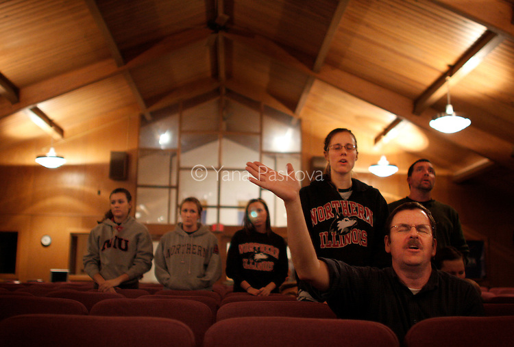 People pray and sing at the Harvest Bible Chapel, which held a vigil after a gunman's shooting rampage killed 5 people and injured 16 others at Northern Illinois University in Dekalb, Illinois, on February 14, 2008. (Photo by: Yana Paskova for The New York Times)..Assignment ID: 30057202A...