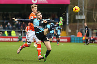 Jason McCarthy of Wycombe Wanderers clears the ball during the Sky Bet League 2 match between Wycombe Wanderers and Luton Town at Adams Park, High Wycombe, England on 6 February 2016. Photo by David Horn.