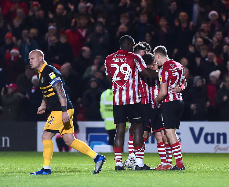 Lincoln City's Tom Pett celebrates scoring his side's third goal with team-mates<br /> <br /> Photographer Andrew Vaughan/CameraSport<br /> <br /> The EFL Sky Bet League Two - Lincoln City v Newport County - Saturday 22nd December 201 - Sincil Bank - Lincoln<br /> <br /> World Copyright © 2018 CameraSport. All rights reserved. 43 Linden Ave. Countesthorpe. Leicester. England. LE8 5PG - Tel: +44 (0) 116 277 4147 - admin@camerasport.com - www.camerasport.com