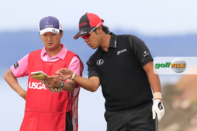 Hideki Matsuyana (JPN) and caddy Daisuke Shindo on the 18th tee during Thursday's Round 1 of the 2015 U.S. Open 115th National Championship held at Chambers Bay, Seattle, Washington, USA. 6/18/2015.<br /> Picture: Golffile | Eoin Clarke<br /> <br /> <br /> <br /> <br /> All photo usage must carry mandatory copyright credit (&copy; Golffile | Eoin Clarke)