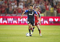 27 August 2011: San Jose Earthquakes forward Chris Wondolowski #8 and Toronto FC defender Ty Harden #20 in action during a game between the San Jose Earthquakes and Toronto FC at BMO Field in Toronto..The game ended in a 1-1 draw.
