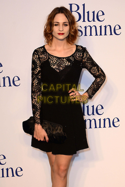 Tuppence Middleton<br /> The &quot;Blue Jasmine&quot; UK film premiere, Odeon West End cinema, Leicester Square, London, England.<br /> September 17th, 2013<br /> half length black dress lace clutch bag hand on hip<br /> CAP/BF<br /> &copy;Bob Fidgeon/Capital Pictures