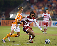 FC Dallas midfielder Juan Toja (8) shields the ball from Houston Dynamo midfielder Stuart Holden (22).  Houston Dynamo defeated FC Dallas 4-1 at Robertson Stadium in Houston, TX on November 2, 2007.  Houston Dynamo won the Western Conference semifinal series with an aggregate score of 4-2.