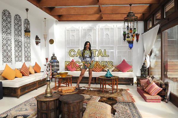 **Exclusive Pictures**.SOFIA HAYAT.Pictured At Her Home In West Kingsdown, Kent, 28th August 2009..full length interior house inside property silver snakeskin print animal dress sofa moroccan furniture style .CAP/FIN.©Steve Finn/Capital Pictures
