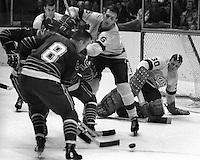 California Golden Seals vs the Los Angeles Kings..<br />King goalie Wayne Rutledge, #6 Dale Rolfe. Seals<br />                           (1969 photo/Ron Riesterer)