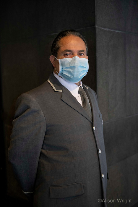 4/10/20-New York, New York City, during the time of Coronavirus. The doormen in New York City are considered to be essential workers and suit up for the job to protect against the COVID virus. They continue to intercept food deliveries, packages, and keep the buildings safe.