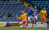 Danny Rowe of Wycombe Wanderers slides in for a tackle during the Sky Bet League 2 match between Portsmouth and Wycombe Wanderers at Fratton Park, Portsmouth, England on 23 April 2016. Photo by Andy Rowland.