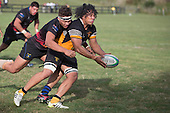 Leroy Jack tackles Waikato Maka during the Counties Manukau Premier Club rugby game between Te Kauwhata and Onewhero, played at Te Kauwhata on Saturday April 16th 2016. Onewhero won the game 37 - 0 after leading 13 - 0 at Halftime. Photo by Richard Spranger.