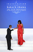 United States President Barack Obama (L) prepares to dance with first lady Michelle Obama at the Commander-in-Chief Ball on January 21, 2013 in Washington, DC. Pres. Obama was sworn-in for his second term as president during a public ceremonial inauguration earlier in the day.  .Credit: Justin Sullivan / Pool via CNP