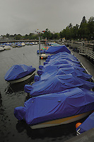 Jet skis under blue pastic tarpaulin in Fredrichshafen harbour on Lake Bodensee. Bavaria, Germany.motorized, recreation,lake sport,