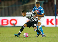 Juventus' Roberto Pereyra is challenged by Napoli's Faouzi Ghoulan  during the  italian serie a soccer match,    at  the San  Paolo   stadium in Naples  Italy , September 26 , 2015