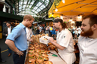 15 June 2017 - Prince Harry buys doughnuts from Bread Ahead stall during a visit to Borough Market in London which has opened yesterday for the first time since the London Bridge terrorist attack.. Photo Credit: ALPR/AdMedia