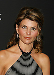 BEVERLY HILLS, CA. - February 17: Actress Lori Loughlin arrives at the 11th Annual Costume Designers Guild Awards at the Four Seasons Beverly Wilshire Hotel on February 17, 2009 in Beverly Hills, California.