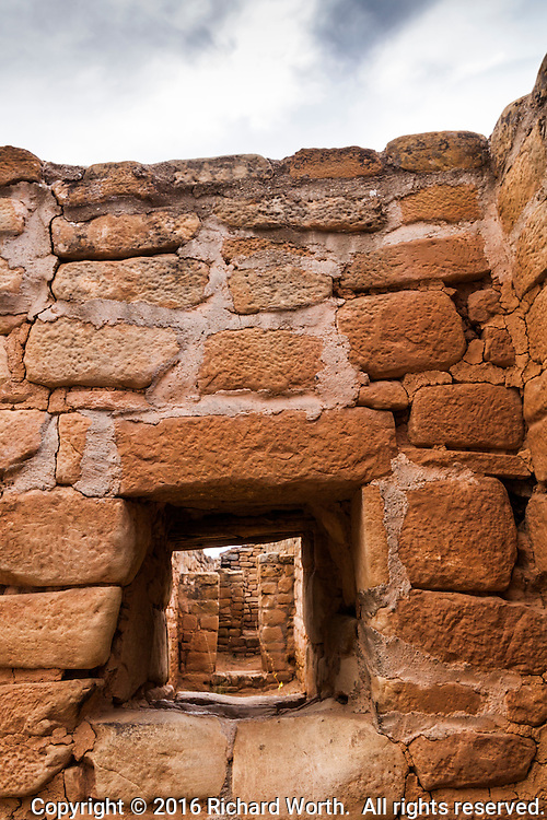 Looking through a window in an exterior wall that includes a passageway, and seeing receding doors and windows - Sun Temple at Mesa Verde National Park, southwestern Colorado.