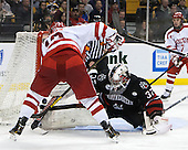Garrett Noonan (BU - 13), Chris Rawlings (NU - 37) - The Northeastern University Huskies defeated the Boston University Terriers 3-2 in the opening round of the 2013 Beanpot tournament on Monday, February 4, 2013, at TD Garden in Boston, Massachusetts.