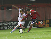 Salim Khelifi (left) pressured by Vaspurak Minasyan in the Armenia v Switzerland UEFA European Under-19 Championship Qualifying Round match at New Douglas Park, Hamilton on 11.10.12.