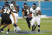 30 March 2012:  FIU's Shane Coleman (20) carries the ball at the FIU Football Spring Game at University Park Stadium in Miami, Florida.